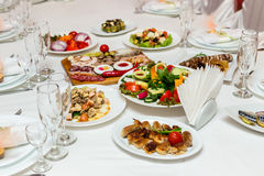 Dishes on banquet table Royalty Free Stock Photos