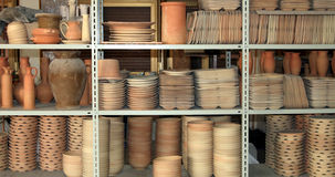 Dishes from clay. Clay shapes on the shelves factory Royalty Free Stock Photo