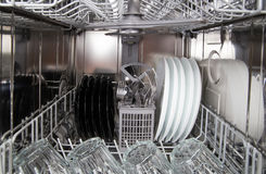 Dishes after cleaning in dishwasher machine Royalty Free Stock Photography