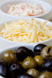 Dishes of coleslaw, grated cheese and olives Royalty Free Stock Photo