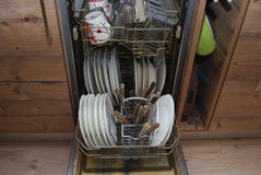 Dishes and cutlery in the dishwasher. Stock Photo