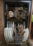 Dishes and cutlery in the dishwasher. Royalty Free Stock Photo