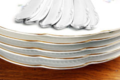 Dishes and cutlery set Royalty Free Stock Photos