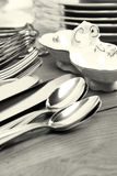 Dishes and cutlery set Stock Photos
