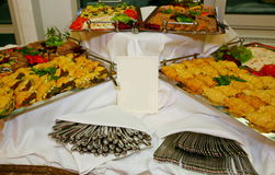 Dishes with delicacies on the buffet table. Main dishes served in international buffet restaurant at hotel Stock Photo