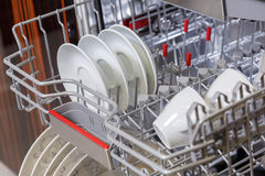 Dishes in dishwasher machine Stock Photography