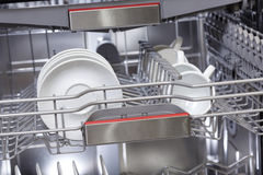 Dishes in dishwasher machine Stock Images