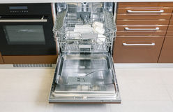 Dishes in dishwasher machine Stock Photos