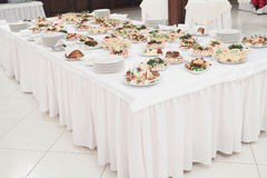 Dishes and food on the served table Royalty Free Stock Photos