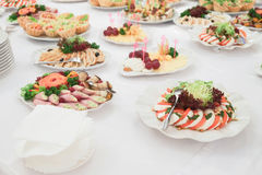 Dishes and food on the served table Stock Image