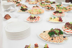 Dishes and food on the served table Stock Photos