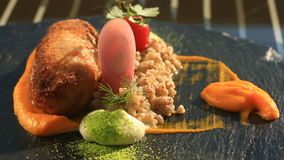 Dishes at the gourmet restaurant. Close-up. Cutlet from rabbit meat with a garnish of green buckwheat.  stock footage