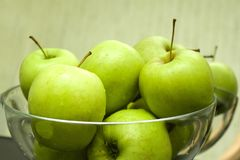 Dishes with green apples. stock photo