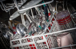 Dishes inside modern dishwasher Royalty Free Stock Image