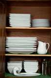 Dishes in Kitchen Cabinet Stock Image