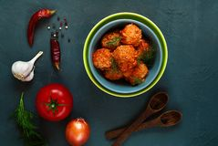 Dishes made of minced meat in the form of balls with spices and tomatoes, the concept of a gastronomic meat, Swedish cuisine stock image