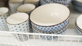 Dishes in market. on the shelf in store. Plate and cups royalty free stock image