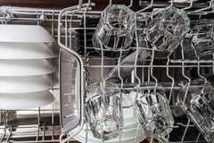 Dishes in a modern dishwasher machine Stock Image
