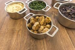 Dishes that are part of the traditional feijoada, typical Brazilian food. Black beans, cabbage, crackers, white rice, dried meat, paio royalty free stock images