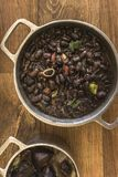 Dishes that are part of the traditional feijoada, typical Brazilian food. Black beans, cabbage, crackers, white rice, dried meat, paio stock photography
