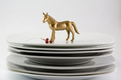 Dishes Plates stacked white and clean tableware and gold horse, Stock Photography