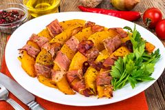 Dishes from pumpkin with bacon. Studio Photo stock photos