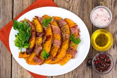 Dishes from pumpkin with bacon. Studio Photo royalty free stock images
