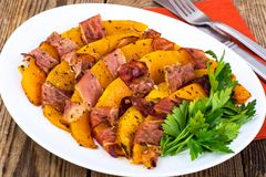 Dishes from pumpkin with bacon. Studio Photo stock photography