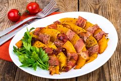 Dishes from pumpkin with bacon. Studio Photo royalty free stock photos