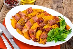 Dishes from pumpkin with bacon. Studio Photo royalty free stock photography