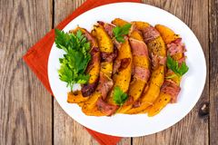 Dishes from pumpkin with bacon. Studio Photo royalty free stock photo