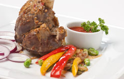 Dishes of roast meat Stock Images
