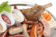 Dishes of roast meat with vegetables and spices Stock Photography