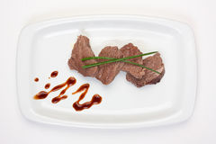 Dishes of roast meat Stock Image