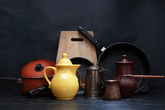 Dishes Set On Dark Stock Images