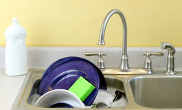 Dishes in the sink Royalty Free Stock Image