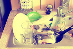 Dishes in the sink Stock Photo