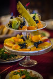 Dishes with sliced fresh fruit on a festive table Royalty Free Stock Photography