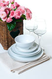 Dishes, towels and a basket of flowers Royalty Free Stock Photo