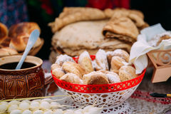Dishes of the traditional Belarusian cuisine - fresh pastries and honey. The dishes of the traditional Belarusian cuisine - fresh pastries and honey Royalty Free Stock Image