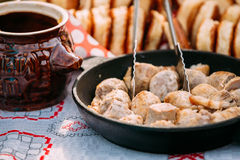 Dishes of the traditional Belarusian cuisine - fried bacon and m Stock Images