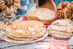 Dishes of the traditional Belarusian cuisine - pancakes. The dishes of the traditional Belarusian cuisine - pancakes. Attribute of traditional folk celebration Royalty Free Stock Image