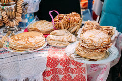 Dishes of the traditional Belarusian cuisine - pancakes. The dishes of the traditional Belarusian cuisine - pancakes. Attribute of traditional folk celebration Stock Photo