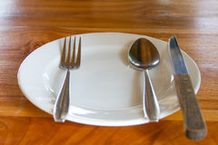 Dishes, utensils and cutlery placed Stock Photos