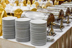 Dishes and warming trays for buffet line Stock Photo