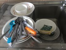 Dishes washing royalty free stock image