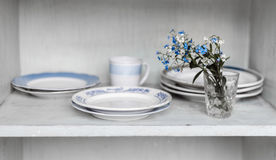 Dishes on wooden shelf. Royalty Free Stock Image