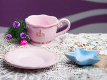 Dishes on wooden table with crochet doily Royalty Free Stock Photo