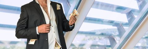 Disheveled businessman in a black suit and money in pockets Royalty Free Stock Photos