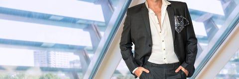 Disheveled businessman in black suit Stock Photo